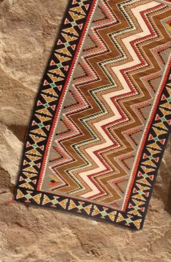 Navajos of the Four Corners area have been making Teec Nos Pos weavings since the early 1900s. This example features the brilliant colors and bold geometric designs that make this type a favorite. Measuring 93½ by 49 inches, it sold at mid-estimate at $2,530. Cowan's Auctions Inc.