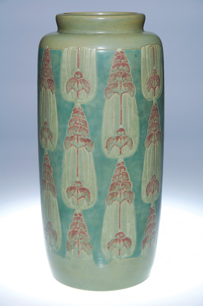 An early example of the Overbecks' Arts & Crafts style, this 14 1/4-inch vase sold for $67,850 at Cincinnati Art Galleries in June of 2007, at that time an auction record for an Overbeck piece with a floral motif. Image courtesy Cincinnati Art Galleries.
