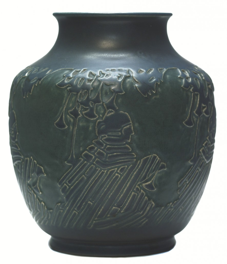 Cloaked women are carved on the sides of this 6 1/2-inch blue matte vase. Image courtesy Treadway Toomey.
