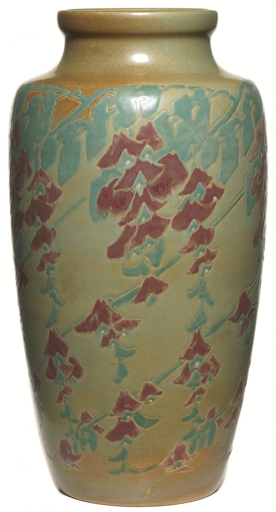Large Overbeck vases are especially desirable. This 14 1/2-inch vase is decorated with a carved and painted design of red stylized fuchsia and is signed with the artists' initials E and H. Image courtesy Treadway Toomey.