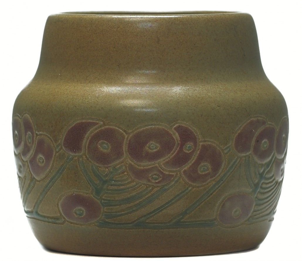 Even small Overbeck pots like this 2 1/2-inch vase are held in high esteem when the look is right. Decorated with a carved and painted floral design in a tan and mauve glaze, this little vessel sold at auction in May 2006 for $5,750. Courtesy Treadway Toomey Galleries.
