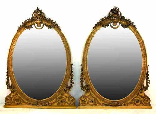 Pair of rare Victorian gilt-carved, over-the-mantel mirrors, circa 1860, with a floral and urn decorated crest ($13,800).