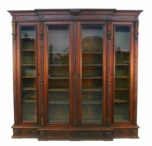 American Renaissance Revival walnut bookcase, circa 1870, with raised burl panels and architectural carved detail ($14,375).