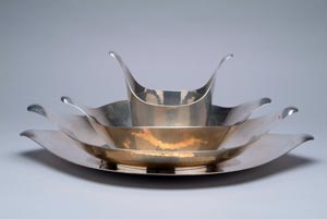 Zeisel's 1957 design for nesting bowls inspired this hammered sterling silver set crafted in 1999 by Michael Brophy. Image courtesy of Erie Art Museum.