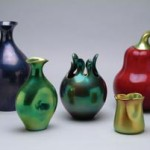 Eva Zeisel designed these porcelain vases with iridescent glaze for Zsolnay. They were produced in 1999. Image courtesy of Erie Art Museum.
