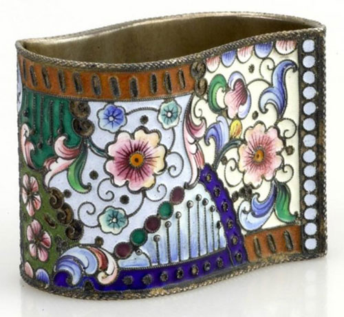 A silver and enamel napkin ring, circa 1902, brought $1,350.