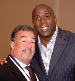 Grey Flannel Auctions president Richard E. Russek with Hall of Famer Earvin Magic Johnson at the Basketball Hall of Fame Induction banquet. Image by Chuck Miller.
