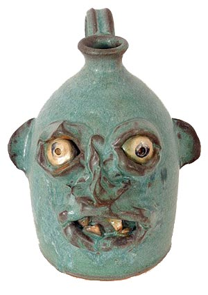 Lanter Hill green-glaze face jug, Seagrove, N.C. Image courtesy LiveAuctioneers Archive and Slotin Folk Art.