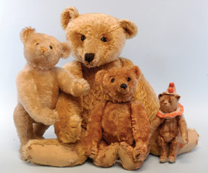 """A large assortment of Steiff bears will be ready for their close-ups at Bertoia's Nov. 7-9 auction, including a coveted and very rare """"rod"""" bear (front and center) that was X-rayed to confirm that it contained the early Steiff rod mechanism. Image courtesy Bertoia Auctions."""