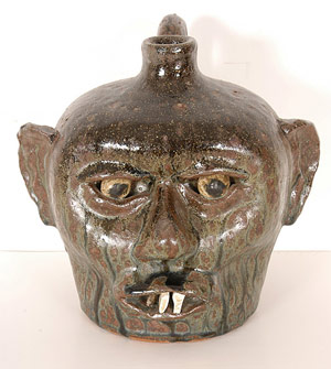 Face jug with china plate teeth, made in the 1960s by renowned potter Lanier Meaders (est. $4,000-$6,000). Image courtesy Slotin Folk Art.