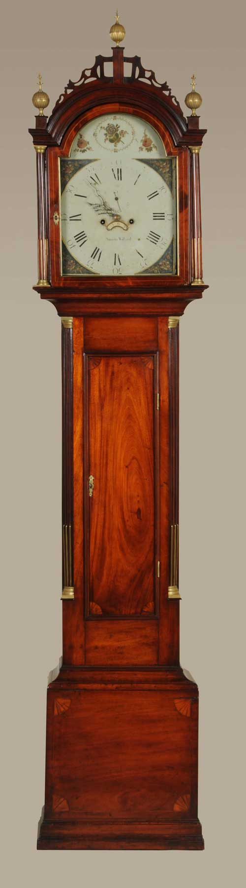 """Circa-1785 Massachusetts Federal tall clock by Simon Willard, figured mahogany Roxbury case with line and fan inlays. Original Simon Willard label. 92½ inches tall with iron dial signed """"Simon Willard."""" Provenance: John and Barbara Delaney. Estimate $40,000-$60,000. Image courtesy Morphy Auctions."""