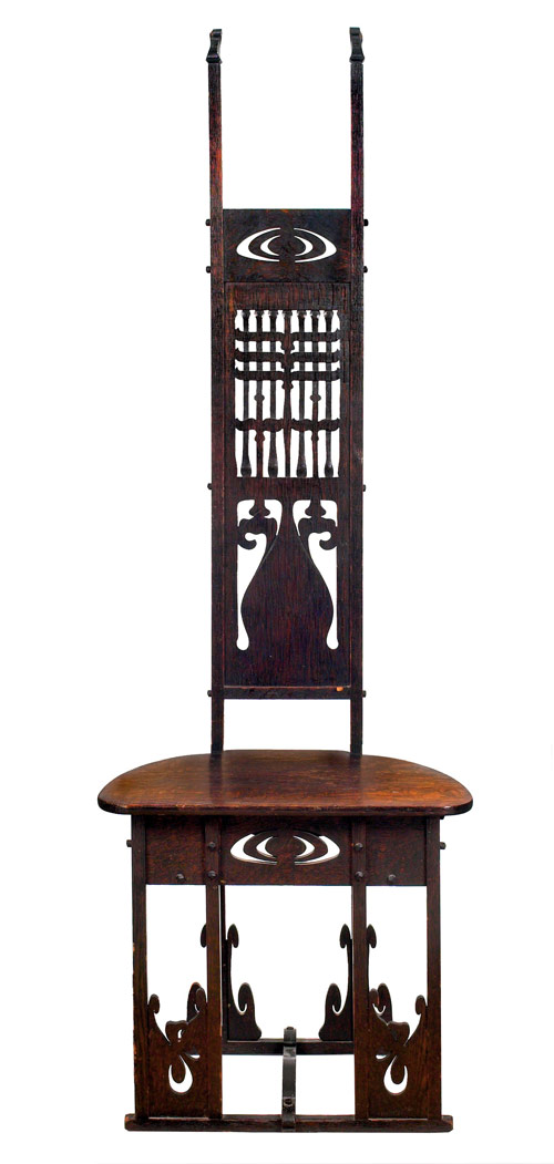 Considered important, this Charles Rohlfs chair with intricate carved and pierced design in the back may reach $30,000-$40,000. Image courtesy Treadway Toomey.