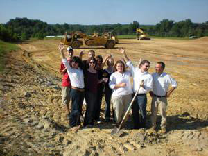 Leland Little, second from left, and his staff celebrated breaking round for the new home of Leland Little Auctions & Estate Sales Ltd. in Hillsborough, N.C., in September.