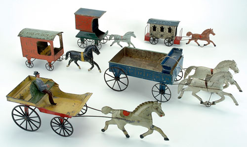A nice array of early hand-painted American tin toys will be on offer in Barrett's sale, a highlight being this blue express wagon made by Merriam. Noel Barrett Auctions image.