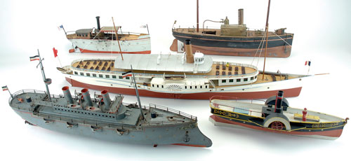A flotilla of toy boats – most made of tin and some of wood – includes an impressive Bing battleship from the early 20th century. Noel Barrett Auctions image.