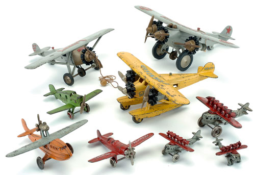 The late Stan Cypher collected all sorts of aeronautical toys, from airplanes to   zeppelins. Here are some great painted cast-iron airplanes made by Hubley of Lancaster, Pa. They include an homage to Lucky Lindy with a miniature of his famed Spirit of St Louis.  Noel Barrett Auctions image.