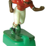 """Tudor's 1968 figurines, including this Kansas City Chiefs player, have thicker legs and are known to collectors as """"hoglegs."""" Hoglegs also have black shoes, a standard trait for 1960's-era electric football players. Chuck Miller image."""