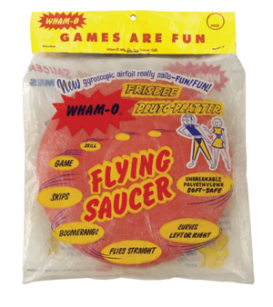 """In the summer of 1958, while Hula Hoop wowed the world, WHAM-O gave the word """"Frisbee"""" top billing on their multi-named flying disc—the WHAM-O Frisbee Pluto Platter Flying Saucer. Photo courtesy of Tim Walsh from his book WHAM-O Super Book: Celebrating 60 Years Inside the Fun Factory (Chronicle Books, 2008)."""