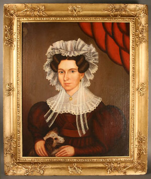 Attributed to New England is this 19th century portrait ofa woman with her dog. The painting is expected to fetch $2,800-$3,200. Image courtesy Case Antiques.
