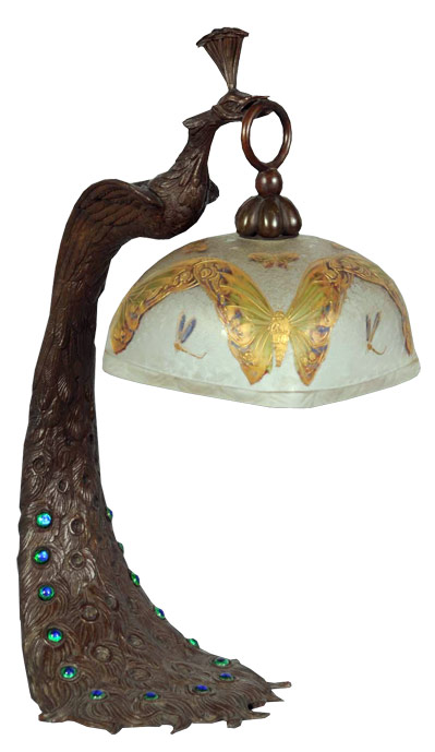 """Austrian bronze Peacock lamp with iridescent inset jewels on the """"tailfeathers,"""" and Mont Joye shade with butterfly-and-dragonfly motif. Estimate $6,000-$8,000. Image courtesy Morphy Auctions."""
