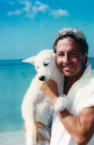 Rauschenberg in a personal moment, strolling Florida's Captiva Beach with his dog, Sapphire, in the early 1990s. Captiva Island provided the perfect refuge for the artist, and it is there that he chose to live out the last period of his life. Photo Courtesy of The Guggenheim Museum, NYC.