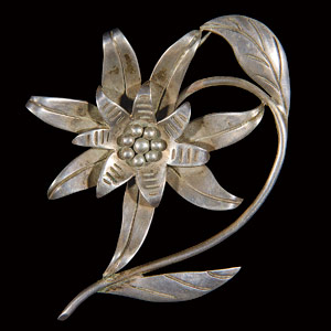 "Hector Aguilar designed a group of floral brooches. This silver blossom pin on arched stem signed with initials ""HA,"" ""Taxco,"" and ""990,"" circa 1940,realized $200. Courtesy Cincinnati Art Galleries."