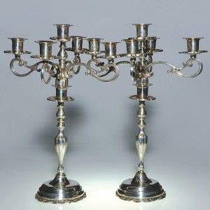 Mexican silversmiths produced tableware for all aesthetic tastes. This pair of sterling silver candelabra in traditional style (height 20 inches, weight 184 troy ounces). Courtesy Cincinnati Art Galleries.