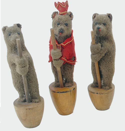 A trio of stuffed mohair bear skittles on wood bases, each with shoe-button eyes and a trademark Steiff ear button, was bid to $2,750. Image courtesy Noel Barrett Auctions.