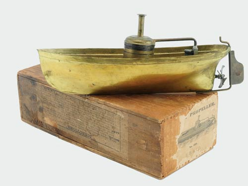Nautical toy enthusiasts and early American toy collectors vied for this 1882 Ives Blakeslee Neptune live steam launch with box, which sailed to a winning bid of $5,225. Image courtesy Noel Barrett Auctions.
