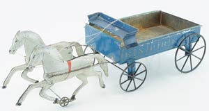 Possibly a unique example, this Merriam 20-inch stenciled and painted-tin express wagon with cast-iron wheels was patented in 1873. It trotted off to a new owner for $7,150. Image courtesy Noel Barrett Auctions.
