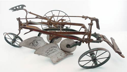 Remarkably realistic, a 44-inch-long working sales sample of a Peru Plow & Wheel Co. double gang plow cultivated a hefty price at auction. It sold for $12,100 against an estimate of $3,000-$4,000. Image courtesy Noel Barrett Auctions.