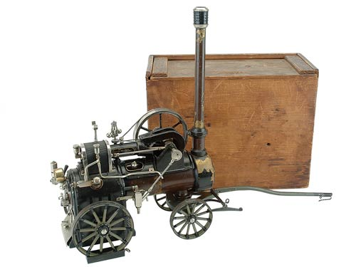 Hotly pursued by bidders on both sides of the Atlantic, a Marklin Traction Engine #4153 with original wood box and all accessories rolled over its $7,000-$9,000 estimate to settle at $13,200. Image courtesy Noel Barrett Auctions.