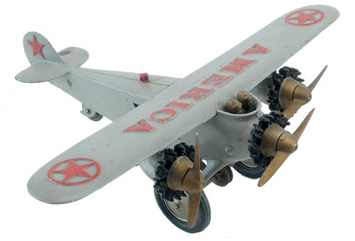 A painted-cast-iron Hubley America tri-motor airplane with three operating propellers is an example of what many collectors identify as the largest cast-iron toy plane ever made. It landed at $4,950. Image courtesy Noel Barrett Auctions.