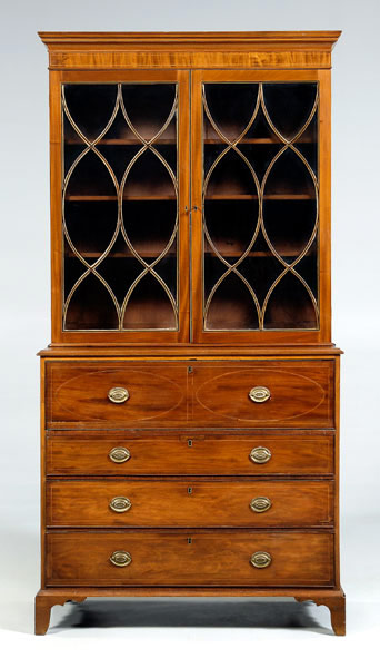 The brasses have been replaced on this 1795-1805 Charleston inlaid secretary bookcase in mahogany with white pine secondary. The top drawer of the lower case opens to a butler's desk. From a venerable Georgetown, S.C., family, the piece is expected to sell for between $30,000 and $50,000 after a $25,000 reserve. Image courtesy Brunk Auctions.