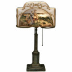 Pilgrims are painted inside the glass shade on this 24 3/4-inch-high Pairpoint lamp. It sold at Brunk Auctions in Asheville, N.C., for $4,140.