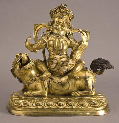 The Chinese Qing Dynasty gilt bronze god of prosperity is depicted in this Qing Dynasty gilt bronze, which raised $8,963. Image courtesy Dallas Auction Gallery and LiveAuctioneers.com Archive.