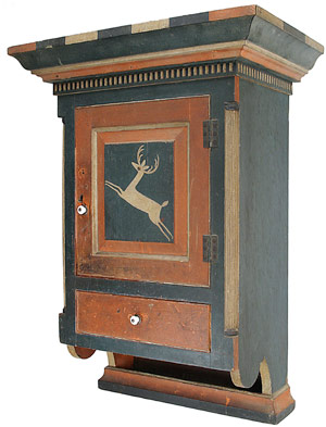 The Johannes Spitler-decorated Virginia hanging cupboard Jeff Evans sold at Green Valley Auctions on Nov. 12, 2004. It still holds the record for a piece of painted American furniture sold at auction - $962,500 – and inspired the new company's logo. Courtesy Green Valley Auctions.