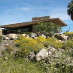 The exterior of the Edris house is clad in wood and stone, with deep roof overhangs to cool the house beneath the desert sun. Photo courtesy of J.R. Roberts.