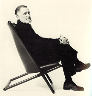 Ward Bennett with his 1968 Scissor Chair, a popular design manufactured by Brickel, said to be his most comfortable chair. Shown here in wood and leather, the Scissor is also manufactured in steel. Image courtesy of Sollo Rago Modern Auctions.