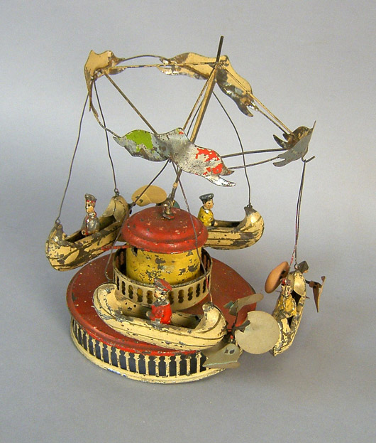 This tin clockwork merry-go-round dates to the 19th century. It is 11 inches high. Image courtesy Pook & Pook.