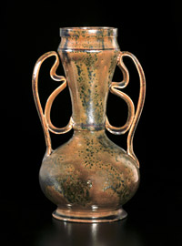 Ohr's two-handle vases are collector favorites. This example with mottled gunmetal and amber glaze sold for $36,000. Courtesy Rago Arts and Crafts Auctions.