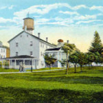 Canterbury Shaker Village as depicted on a 1920 postcard, courtesy Wikipedia.