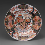 This large 17th century Japanese Imari plate – over 21 inches in diameter – is decorated in underglaze blue and overglaze enamels. The central medallion is decorated with a stylized lion and peonies. Image courtesy Seattle Art Museum.