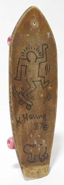 Untitled, 1987, original ink drawing on wood skateboard deck, by Keith Haring. Estimate $8,000-$12,000. Courtesy Phillips de Pury & Co.