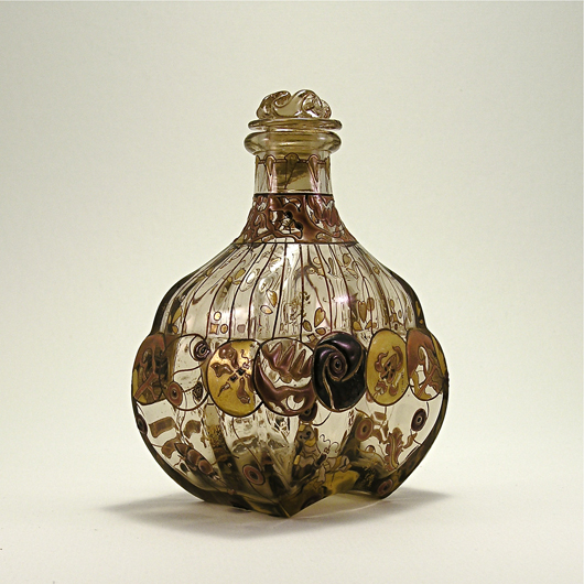1880s Emile Gallé Art Nouveau perfume bottle and stopper in light topaz glass with gilding and enameled fantasy decoration of floral and insect medallions. Signed E. Gallé, Nancy. $4,000-$6,000