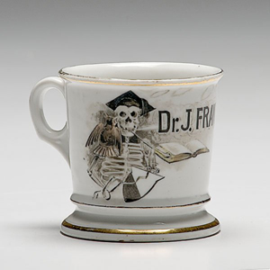 'Dr. J. Frank Gardner' once owned this unusual shaving mug decorated with a hand-painted skeleton. Image courtesy Cowan's Auctions.
