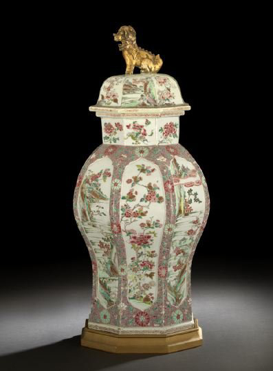 Eight panels of this Famille Rose jar alternate between landscape and peony decoration. Topped with a Foo Dog, the 27-inch jar has a $4,000-$7,000 estimate.