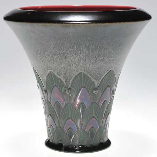 Sara Sax decorated this Rookwood French Red vase with Art Deco stylized flowers. Dated 1922, the 5 1/4-inch vase has a $7,000-$9,000 estimate. Image courtesy Cincinnati Art Galleries.