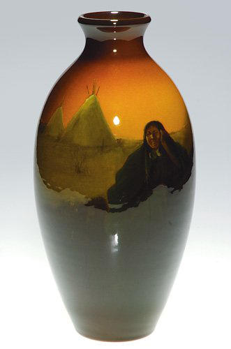 Indians are often found on Rookwood Standard Glaze vases, but Kataro Shirayamadani's take on the subject, a squaw and teepees, is unusual. Image courtesy Cincinnati Art Galleries.