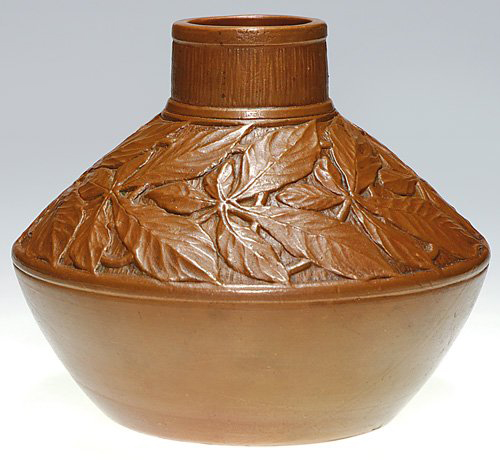 Elaborate electroplated copper cladding covers the exterior of this Tiffany pottery vase, which has a 10,000-$13,000 estimate. Image courtesy Cincinnati Art Galleries.